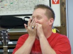 Scott Humphrey playing harmonica.